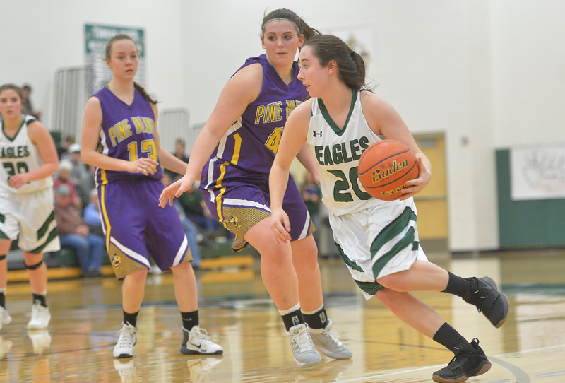 Justin Sheely | The Sheridan Press<br /> Tongue River's Jenna Keller drives the ball against the Lady Hornets at Tongue River High School in Dayton Thursday, Jan. 4, 2018. The Lady Eagles lost to Pine Bluffs 59-32.