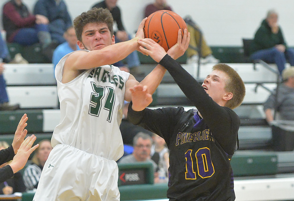 Justin Sheely | The Sheridan Press<br /> Tongue River's Jaren Fritz is fouled by Pine Bluffs' Andrew Fornstrom at Tongue River High School in Dayton Thursday, Jan. 4, 2018.