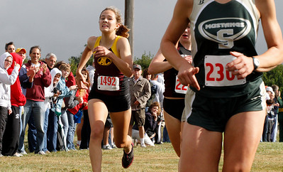 09/04/2010  Avon Lake's Katy Link (left) dashes to the finish line to finish 10th Photo by Tom Mahl