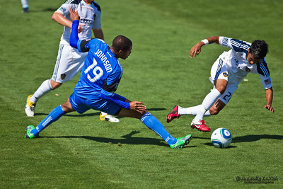 SANTA CLARA, CA - JUNE 25: LA Galaxy player A.J. DeLaGarza compete for the ball with Earthquakes  player Ryan Johnson during the MLS soccer game Earthquakes vs LA Galaxy, on June 25, 2011 at the Buck Shaw Stadium in Santa Clara, CA.