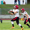 Record-Eagle/Brett A. Sommers East Jordan running back Spencer Reid fields a punt he would return 65 yards for a touchdown during Thursday's game against East Jordan. The Red Devils won 38-14.