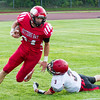 Record-Eagle/Brett A. Sommers Suttons Bay running back Baylor Mikesell gets by East Jordan's Trey Peterson during Thursday's game in Suttons Bay. The Red Devils won 38-14.