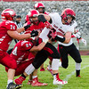 Record-Eagle/Brett A. Sommers East Jordan running back Ryan Graham carries the ball as Suttons Bay's Baylor Mikesell (24) and the Norsemen defense try to bring him down during Thursday's game in Suttons Bay.