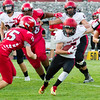 Record-Eagle/Brett A. Sommers East Jordan running back Spencer Reid tries to juke Suttons Bay defender Austin Herr during Thursday's game in Suttons Bay. The Red Devils won 38-14.