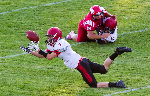 Record-Eagle/Brett A. Sommers East Jordan running back Trey Peterson stretches out for a pass during Thursday's game against East Jordan. The Red Devils won 38-14.
