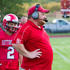 Record-Eagle/Brett A. Sommers Suttons Bay head coach Alex Kohler looks onto the field during Thursday's game in Suttons Bay. The Red Devils won 38-14.