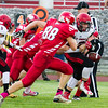 Record-Eagle/Brett A. Sommers East Jordan running back Ryan Graham gets stripped from behind by a pursuing Suttons Bay defender during Thursday's game in Suttons Bay. The Red Devils won 38-14.