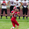 Record-Eagle/Brett A. Sommers Suttons Bay running back Baylor Mikesell catches a pass during Thursday's game against East Jordan. The Red Devils won 38-14.