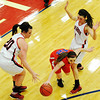 Globe/T. Rob Brown<br /> East Newton's Shelbey Thomlinson drives the ball between Ash Grove's Halee Cashio (20) and Abby Arico (4) Saturday night, Feb. 23, 2013, during the Class 3 District 12 Basketball Tournament at Seneca High School's gymnasium.