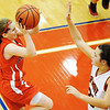 Globe/T. Rob Brown<br /> East Newton's Emily Brummett shoots over Ash Grove's Katie Skelton Saturday night, Feb. 23, 2013, during the Class 3 District 12 Basketball Tournament at Seneca High School's gymnasium.