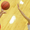 Globe/T. Rob Brown<br /> East Newton's Whitney Thomlinson shoots over Ash Grove's Abby Arico Saturday night, Feb. 23, 2013, during the Class 3 District 12 Basketball Tournament at Seneca High School's gymnasium.