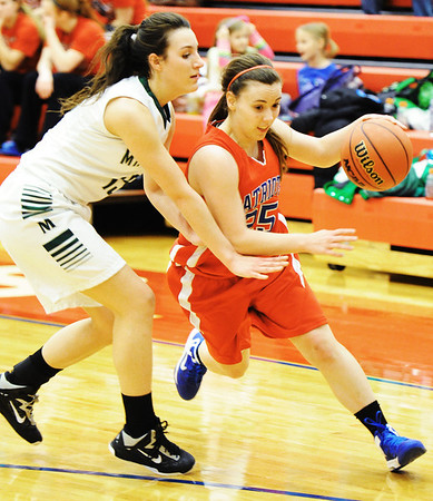 Globe/T. Rob Brown<br /> East Newton's Whitney Thomlinson drives the ball around Mt. Vernon's Blair Tettenhorst during Friday evening's game, Feb. 22, 2013, during the Class 3 District 12 Basketball Tournament at Seneca High School's gymnasium.