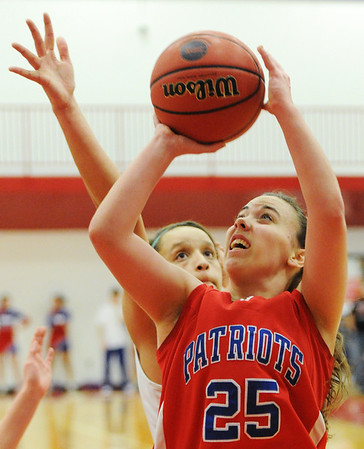 Globe/T. Rob Brown<br /> East Newton's Whitney Thomlinson goes up for a shot under the basket against Mt. Vernon during Friday evening's game, Feb. 22, 2013, during the Class 3 District 12 Basketball Tournament at Seneca High School's gymnasium.