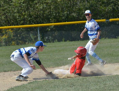 Jaguar shortstop Riley DeLisle tags out Slugger base runner Eli Reed as he attempts to steal second base. (Paula Roberts photo)