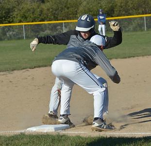 Raider Ethan Reed tags out Reaper Mason Long at third base. (Paula Roberts photo)
