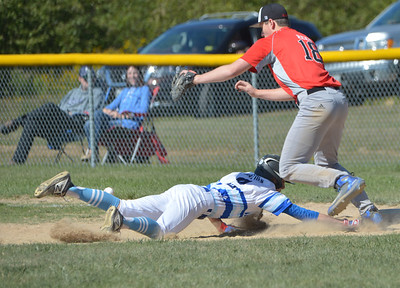 Isaac Hayden dives back to first safe for the Jaguars. (Paula Roberts photo)