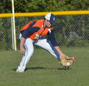 Raider Isaac Simmons gloves a hit to right field. (Paula Roberts photo)