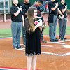 Star Photo/Larry N. Souders<br /> Elizabethton native and Provenance Academy student Madison McClelland sings the National Anthem prior to the Elizabethton Twins playoff game against the Astros of Greeneville Monday night.