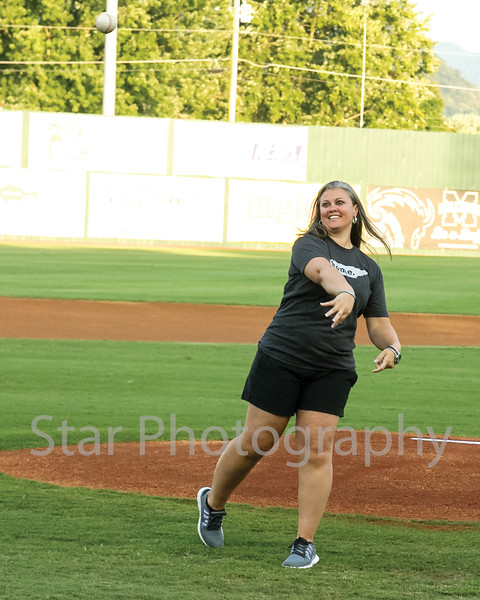 Star Photo/Larry N. Souders<br /> East Tennessee State University head women's basketball coach Brittany Ezell fires a first pitch strike prior to the Elizabethton Twins playoff game against the Astros of Greeneville Monday night.