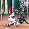 Star Photo/Larry N. Souders<br /> The Astros' Juan Pineda (29) scores on Jose Benjamin (43) single, Twins catcher Rainis Silva (11) waits on the throw of right fielder T.J. Dixon.