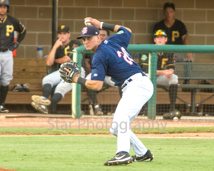 Star Photo/Larry N. Souders<br /> The Twins' third baseman Andrew Bechtold throw out the Pirate's Nick Valaika (43) out his sacrifice bunt, Johan De Jesus advances to third on the play.