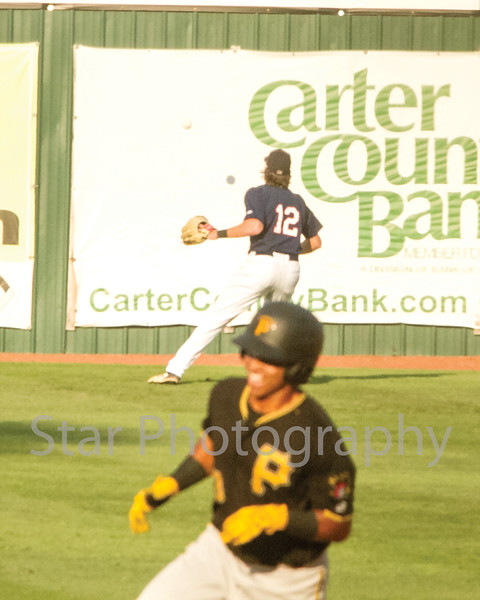 Star Photo/Larry N. Souders<br /> Twins left fielder Matt Albanese (12) has to play the ball's carom off the left field wall on the Pirates Huascar Fuentes (6) double as Edison Lantigua (3) scores on the play in the top of the first.
