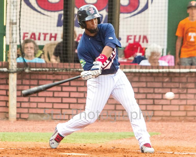 Star Photo/Larry N. Souders<br /> Designated hitter Ariel Montesino (9) slap a  ground ball toward Pirate third baseman Johan De Jesus.