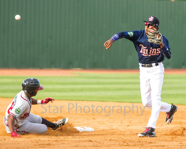 Star Photo/Larry N. Souders<br /> The Braves William Contreras (24) is out at second as the Twins Jose Miranda (27) fires to first to complete the double play .
