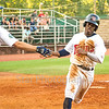 Star Photo/Larry N. Souders<br /> On Jose Miranda (27) line drive single to center T.J. Dixon (41) is greeted by J.J. Robinson as he scores the Twins first run of the night in the bottom of the third.