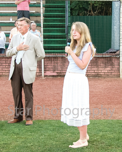 Star Photo/Larry N. Souders<br /> Elizabethton native and Providence Academy seventh grader Emma Grubbs (R) preforms the National Anthem prior to Wednesday nights Twins game against the Pirates of Bristol.