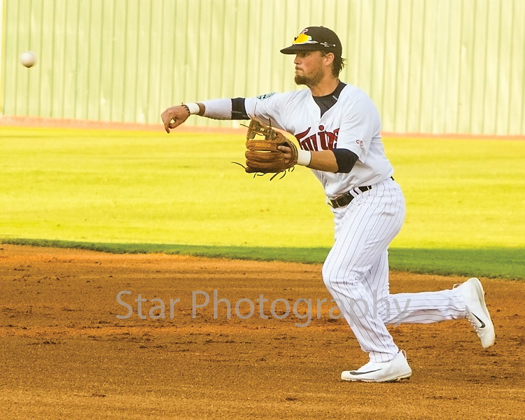Star Photo/Larry N. Souders<br /> Twins second baseman Carson Crites (39) fires to first baseman J.J. Robinson (35) in time to get the Pirates Luis Benitez on his grounder in the second inning.
