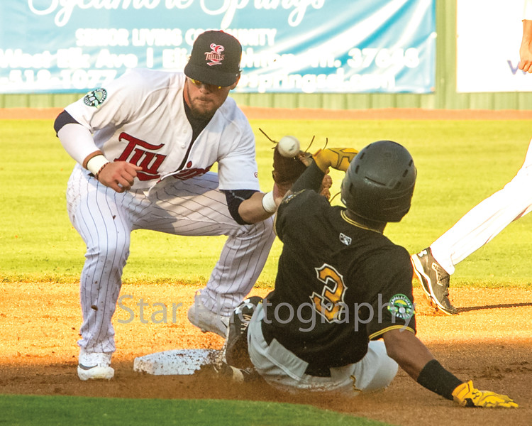 Star Photo/Larry N. Souders<br /> Twins second baseman Carson Crites (39) can't handle the bad hop on the throw from catcher Andrew Cosgrove as the Pirates Edison Lantigua (3) slides into second.