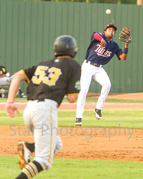 Star Photo/Larry N. Souders<br /> Twins shortstop Wander Javier (7) makes an off balance throw after going into the hole deep on Bristol's Luis Benitez's (54) grounder in time to get Ryan Peurifoy (53) out at second.
