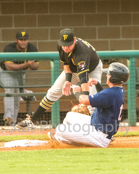 Star Photo/Larry N. Souders<br /> The Twins Rainis Silva (11) is out at third on a great throw from the Pirates right fielder Yondry Contreras (23) to third baseman Ben Bengtson (35) on T. J. Dixon's (41) RBI line drive single to right.
