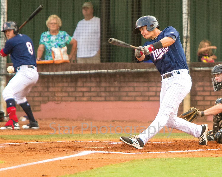 Star Photo/Larry N. Souders<br /> Jose Miranda doubles (27) hits line drive RBI double just fair down the to left field line, Wander Javier (7) scores on the play.