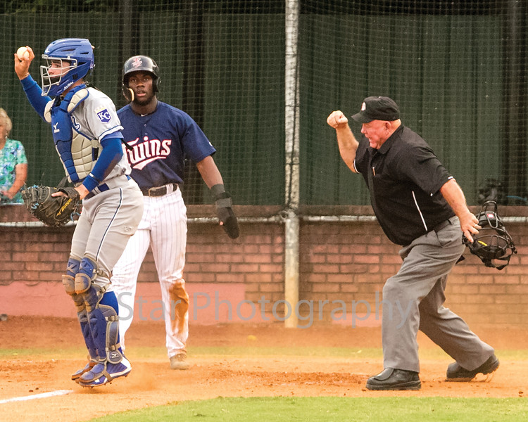 Star Photo/Larry N. Souders<br /> The Twins Akil Baddoo (26) is called out at home by umpire Dale Ford on Shane Carrier singles up the middle, Royals second baseman Oliver Nunez(7) fired home to catcher Sebastian Rivero (3) for the out ending the top of the first.