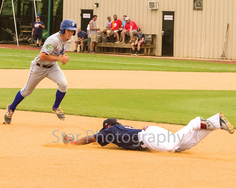 Star Photo/Larry N. Souders<br /> Twins third baseman Ariel Montesino (9) makes a diving stop on the Royals Reed Rohlman (26)  grounder for the final out of the first inning.