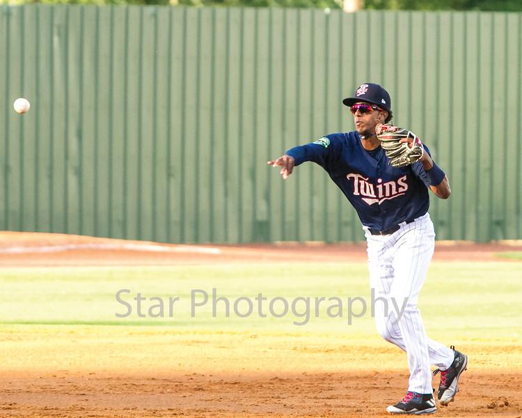 Star Photo/Larry N. Souders<br /> Twins shortstop Wander Javier (7) scoops up Yankee Jesus Bastidas' (12) grounder and fires to first baseman Kolton Kendrick (23) Eduardo Torrealba (13) scores on the fielders choice.