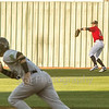 Star Photo/Larry N. Souders<br /> The Twins Trey Cabbage (20) fires to third base after catching Andres Chaparro (18) sacrifice fly to left, holding Yankee base runner Jesus Bastidas (12) at second.