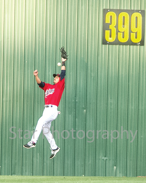 Star Photo/Larry N. Souders<br /> Twins center fielder Mark Contreras (5) miss judges his leap on the Yankees' Victor Rey (43) fly ball double to centerfield.