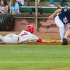 Star Photo/Larry N. Souders<br /> The Cardinals' Brandy Whalen (7) just gets back under the tag on a snap throw by Twins catcher Robert Molina (24) to first baseman J.J. Robinson (35) in the top of the second.