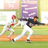 Star Photo/Larry N. Souders<br /> Twins shortstop Wander Javier (7) makes a stabbing catch of the Cards Wood Myers liner, almost doubling Irving Lopez (18) off second on the play.