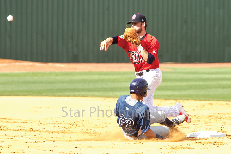 Star Photo/Larry N. Souders<br /> The Rays Kevin Santiago (22) is out at second as the Twins second baseman Carson Crites (39) fires to first to complete the double play on Jose Tonton ground ball ending the second inning.