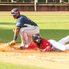 Star Photo/Larry N. Souders<br /> After reaching on a walk with one out in the third inning the Twins Ariel Montesino (9) dives back into first base just ahead of a snap throw for Rays catcher Ronaldo Hernandez (24), first baseman Devin Davis (32) applies the late tag.