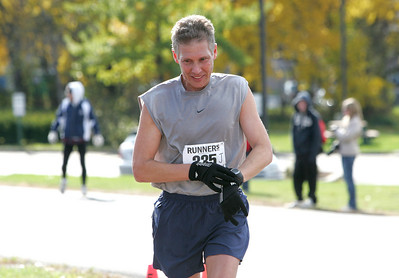 1NOV09  Top 'local' man Don Luscher of Barberton Ohio marks his time for the Elyria Inland Trail Marathon held at Murray Ridge School.   photo bY Chuck Humel
