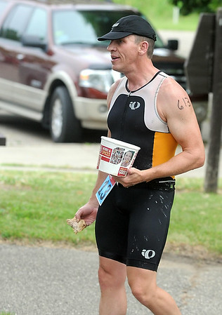 Randy Brendal of Waseca completed the Elysian Rookies Triathlon while carrying a bucket of fried chicken Saturday. Photo by Pat Christman