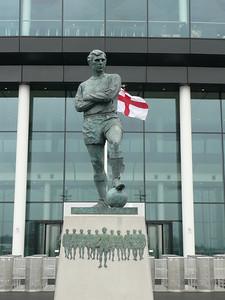 Bobby Moore. First English captain to raise the World Cup.