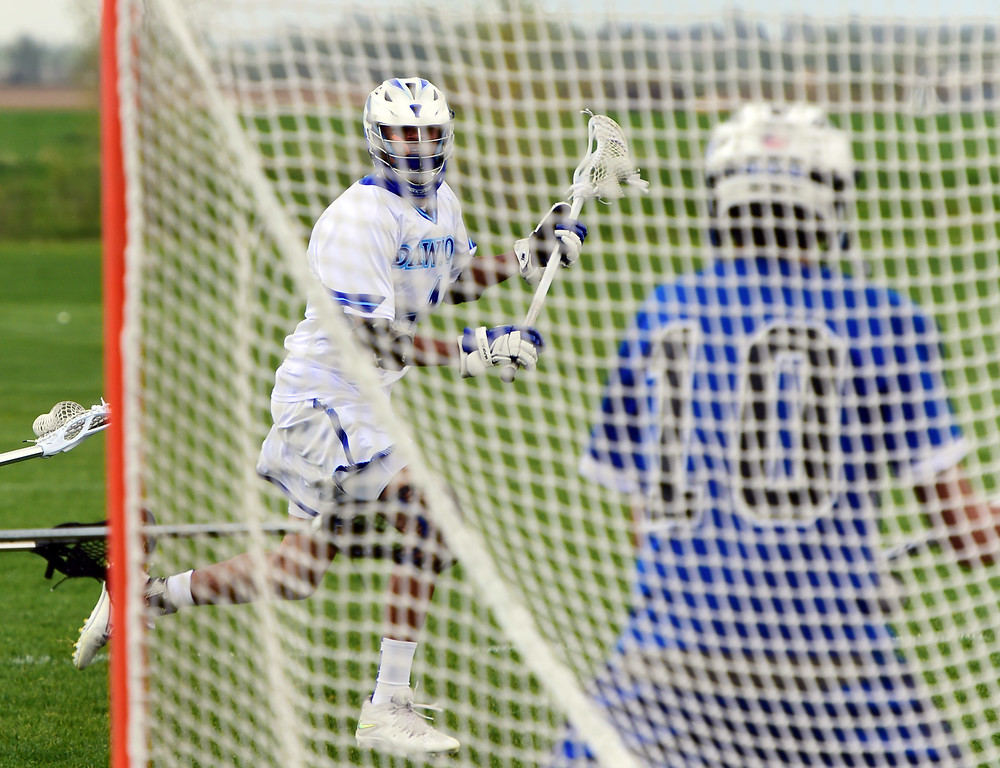 . Wyatt Watts, of Dawson, looks for a scoring chance on goal keeper Robert Boucher, of englewood. For more photos, go to www.bocopreps.com. Cliff Grassmick Staff Photographer May 10, 2016