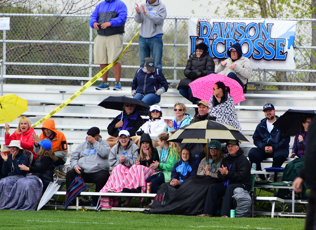 . The fans endured wind and rain at Dawson. For more photos, go to www.bocopreps.com. Cliff Grassmick Staff Photographer May 10, 2016