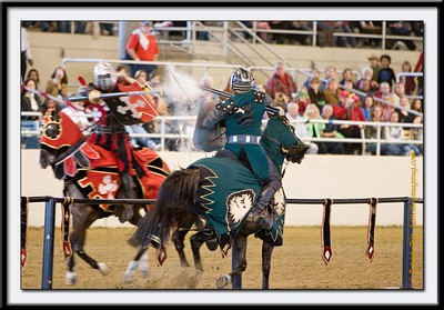 Two knights jousting.